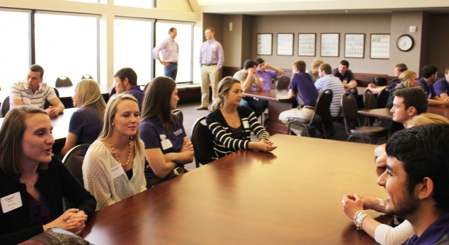 Student Fellows and Advisory Council members socialize before the President's arrival.